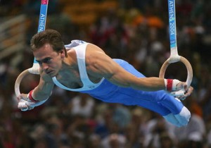 ATHENS - AUGUST 22:  Dimosthenis Tampakos of Greece  competes in the men's artistic gymnastics ring finals on August 22, 2004 during the Athens 2004 Summer Olympic Games at the Olympic Sports Complex Indoor Hall in Athens, Greece. (Photo by Chris McGrath/Getty Images)